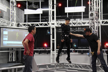 Motion Capture performer suspended from wires